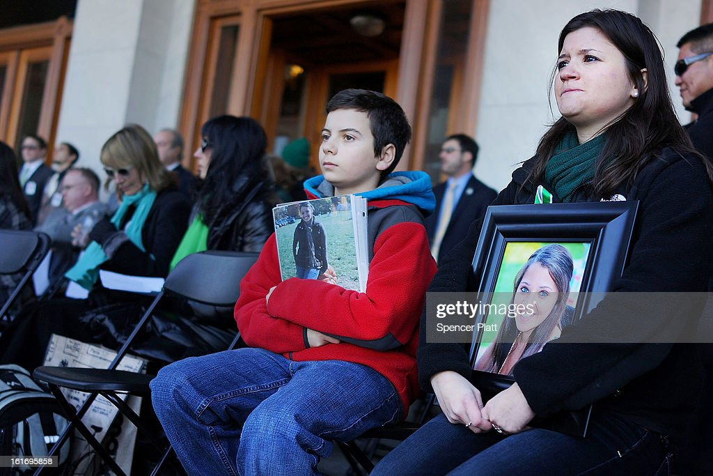 Heather Cronk and Zach Fagan hold up pictures of their cousin Victoria Soto, a first-grade teacher killed at Sandy Hook Elementary School in Newtown, at a rally at the Connecticut State Capital to promote gun control legislation in the wake of the December 14, 2012, school shooting in Newtown on February 14, 2013 in Hartford, Connecticut. Referred to as the 'March for Change' and held on the two-month anniversary of the massacre in Newtown, Connecticut, participants called for improved gun safety laws. Among the safety measures being demanded are for universal background checks, more work within the mental health community and restricting high-capacity magazines.