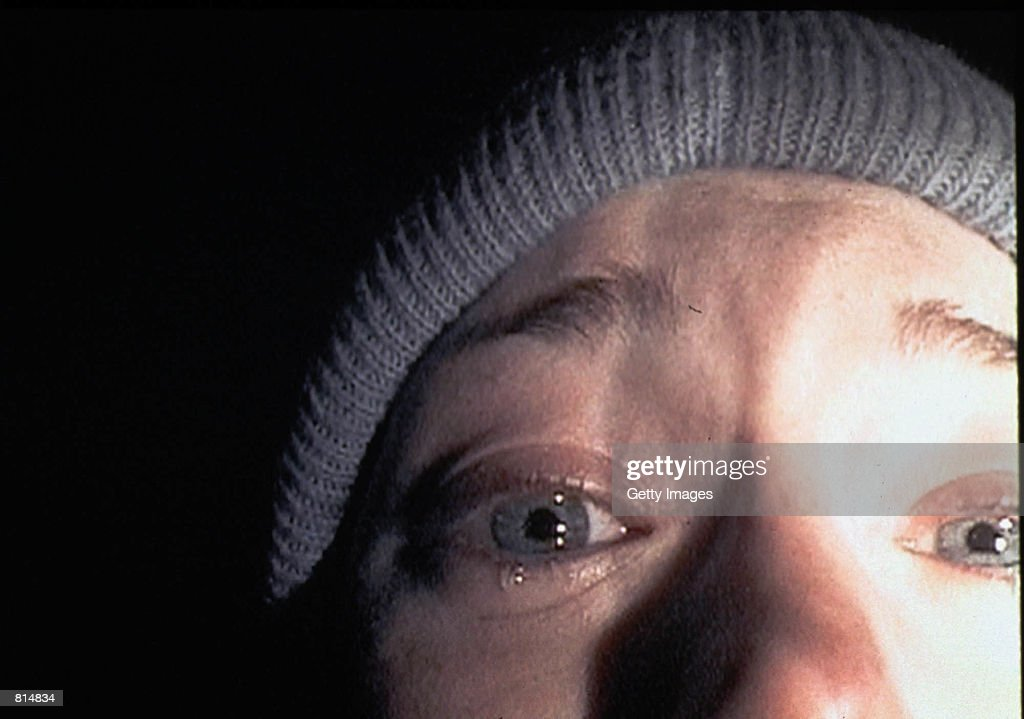 Heather Donahue turns the camera on herself during a harrowing five-day journey through the Black Hills Forest in the low-budget thriller 'The Blair Witch Project.' The film, a mock documentary, is about three students who trek into Maryland's Black Hills to shoot a documentary about a local legend, 'The Blair Witch.' (Photo by Artisan Entertainment