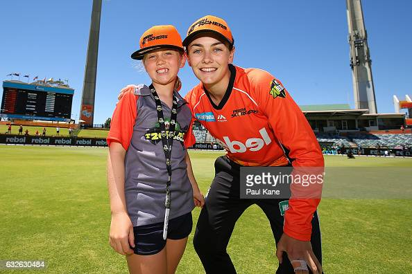 Heather Graham of the Scorchers poses for a photo with a T20 Blast kid during the Women's Big Bash League match between the Perth Scorchers and the...