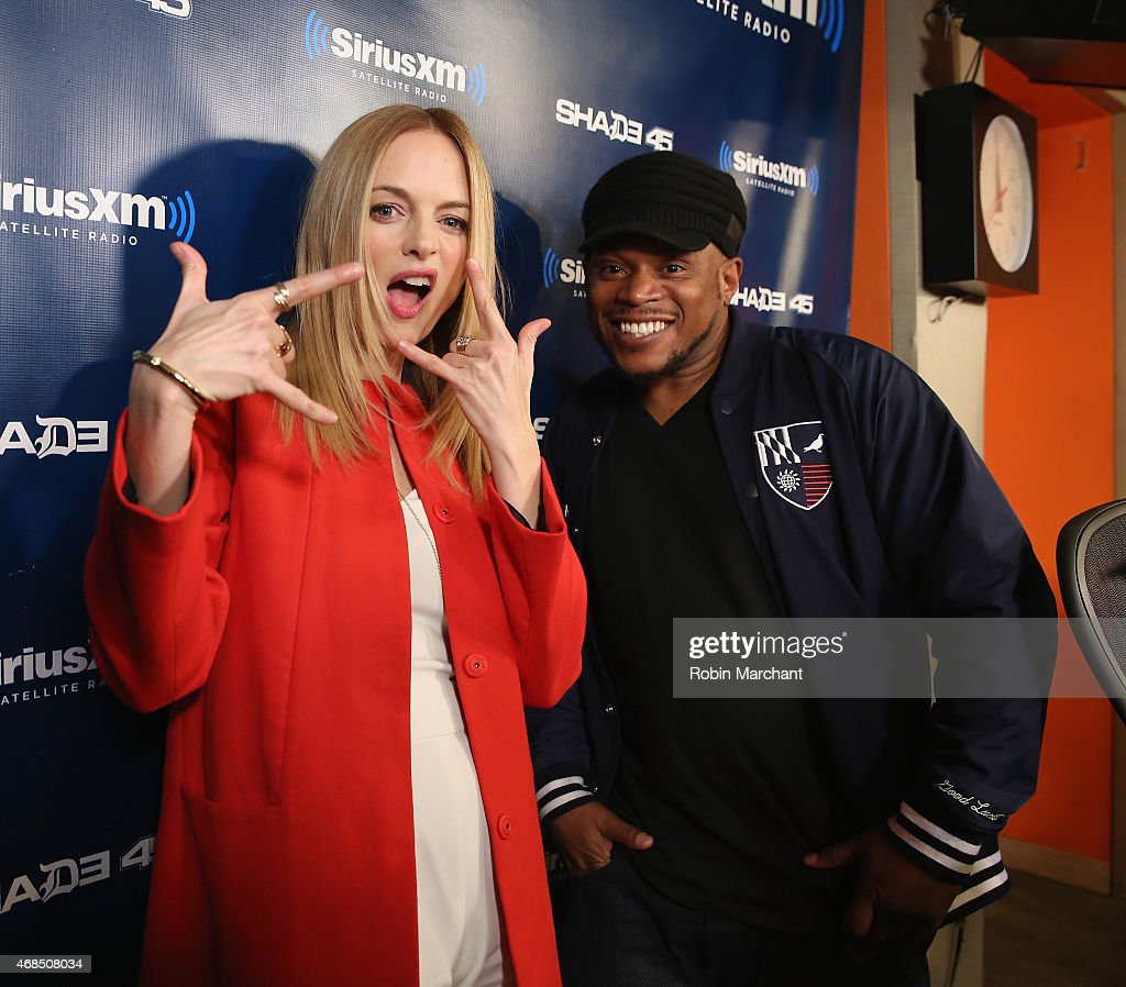 Heather Graham visits 'Sway in the Morning' with Sway Calloway (R) on Eminem's Shade 45 at SiriusXM Studios on April 3, 2015 in New York City.