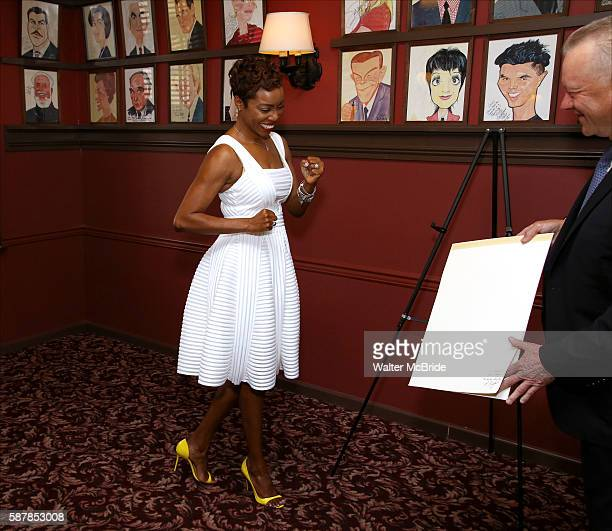 Heather Headley and Max Klimavicius attend the unveiling of Heather Headley's Portrait on the Sardi's Wall of Fame at Sardi's Restaurant on August 9...
