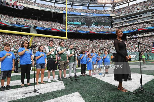Heather Headley performs the National Anthem when she attends the New York Jets versus Cincinnati Bengals game at MetLife Stadium on September 11...