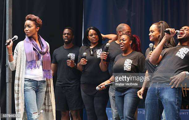 Heather Headley with the cast from 'The Color Purple' performs at United presents 'Stars in the Alley' in Shubert Alley on June 3 2016 in New York...