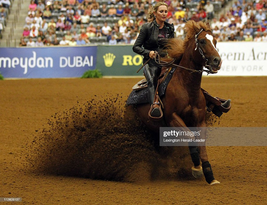 Heather Johnson churns up some dirt to start off the freestyle reining exhibition at the World Equestrian games at Alltech Arena in Lexington, Kentucky, Thursday, September 30, 2010.