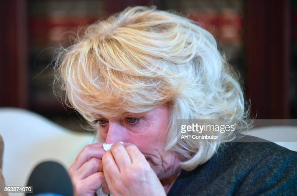 Heather Kerr reacts after speaking during a press conference with attorney Gloria Allred in Los Angeles California on October 20 another woman...