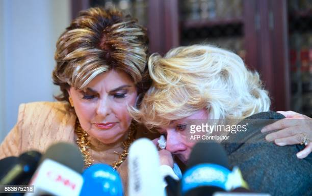 Heather Kerr reacts after speaking in a press conference with attorney Gloria Allred in Los Angeles California on October 20 alleging she was...
