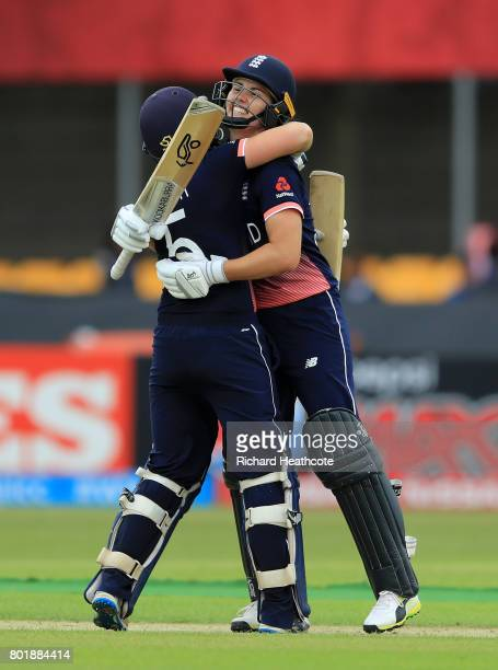 Heather Knight and Natalie Sciver of England celebrate both of them reaching their centuries during the Women's ICC World Cup group match between...