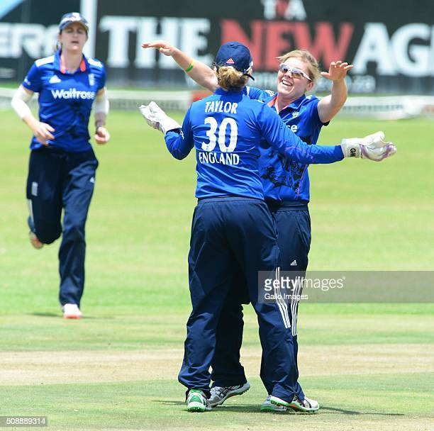 Heather Knight and Sarah Taylor of England celebrate the wicket of Trisha Chetty of South Africa during the One Day International match between South...
