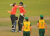 Heather Knight and Sarah Taylor of England celebrate winning the ICC Women's World Twenty20 Bangladesh 2014 2nd SemiFinal match between England Women...
