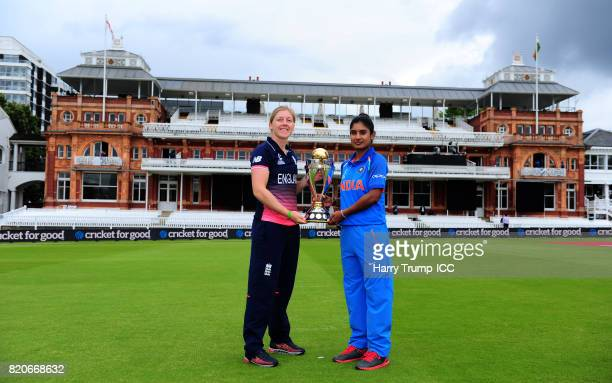 Heather Knight Captain of England and Mithali Raj Captain of India pose with the Women's World Cup Trophy during the England v India Final ICC...