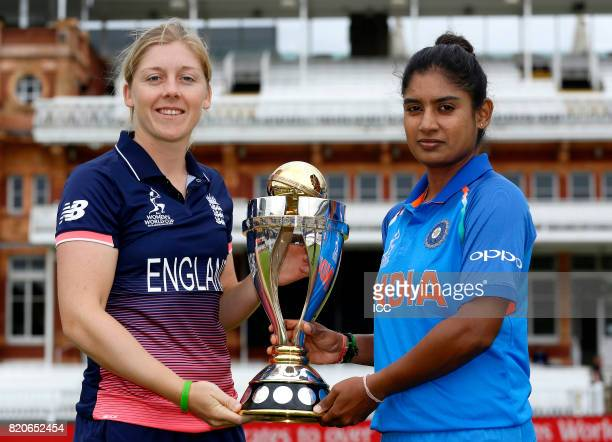 Heather Knight of England and Mithali Raj of India pose with the trophy before The Women's World Cup 2017 final between England and India at Lord's...