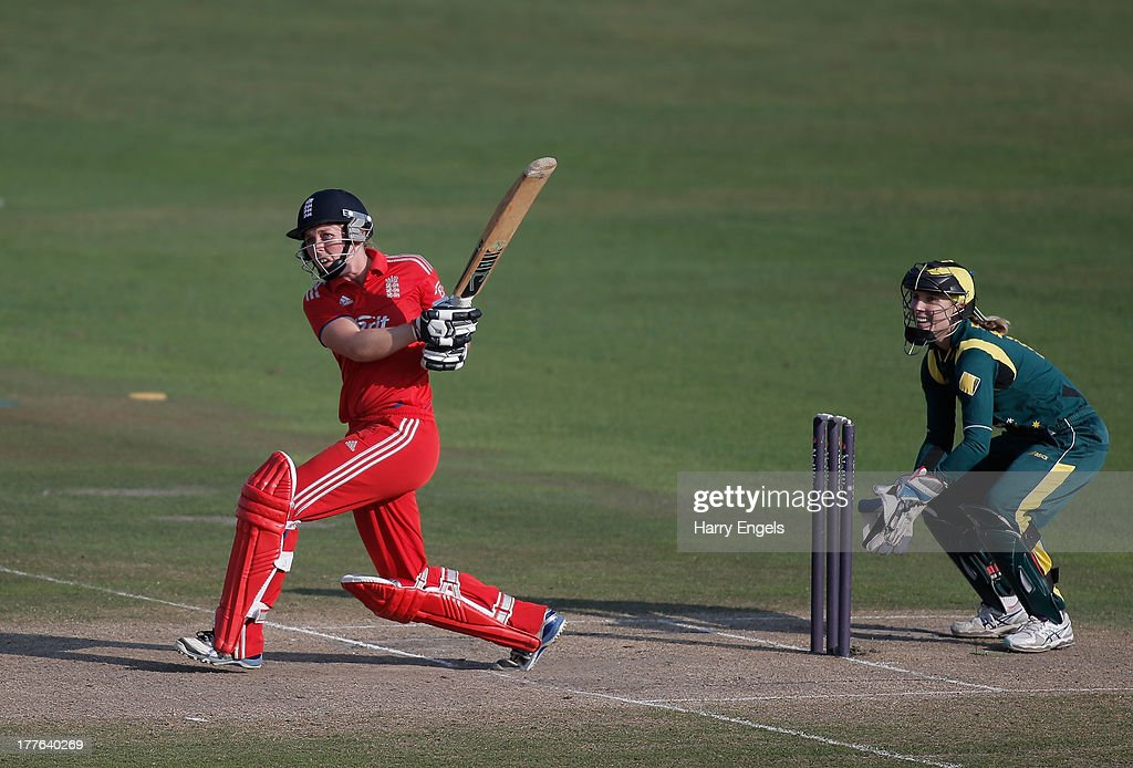 Heather Knight of England hits out watched by Australian wicketkeeper Jodie Fields during the third NatWest One Day International match between England and Australia at the BrightonandHoveJobs.com County Ground on August 25, 2013 in Hove, England.