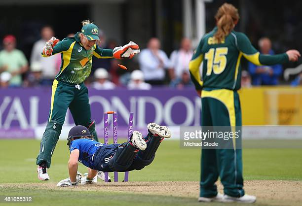 Heather Knight of England is run out by a direct throw from Meg Lanning as wicketkeeper Alyssa Healy celebrates during the 2nd Royal London ODI of...