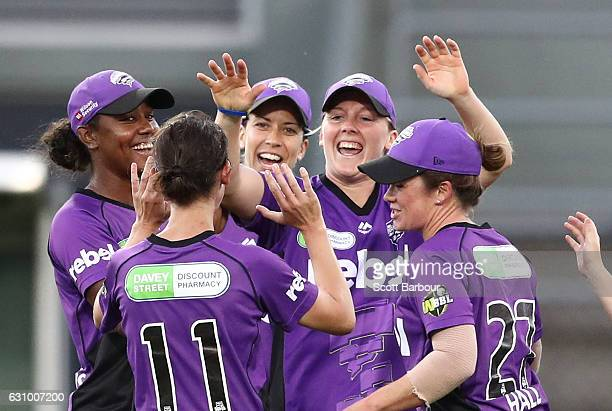 Heather Knight of the Hurricanes is congratulated by her teammates after taking a catch to dismiss Rachael Haynes of the Thunder during the Women's...