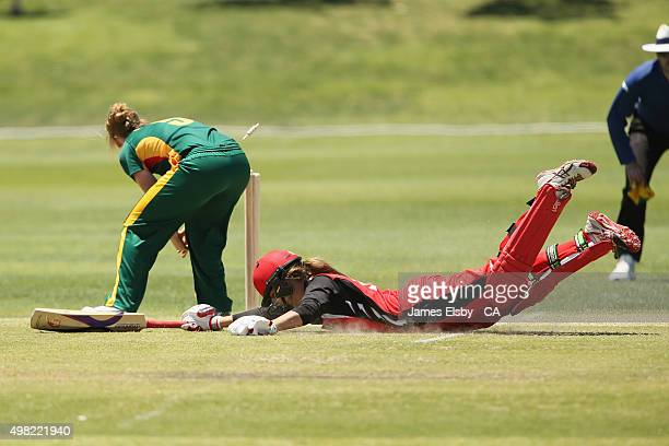 Heather Knight of the Roar attempts to runout Alex Price of the Scorpions during the WNCL match between South Australia and Tasmania at Railways Oval...