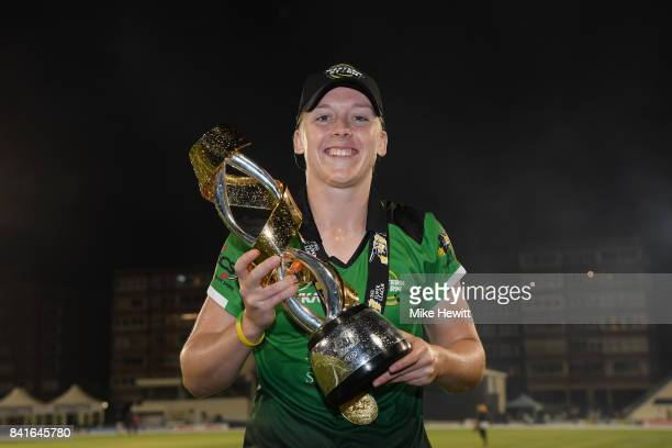Heather Knight of Western Storm poses for a picture with the trophy after winning the Women's Kia Super League Final between Southern Vipers and...