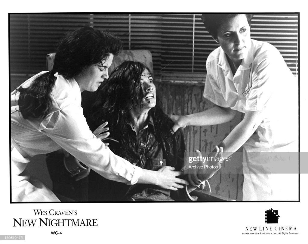 Heather Langenkamp is held back by nurses in a scene from the film 'New Nightmare' 1994