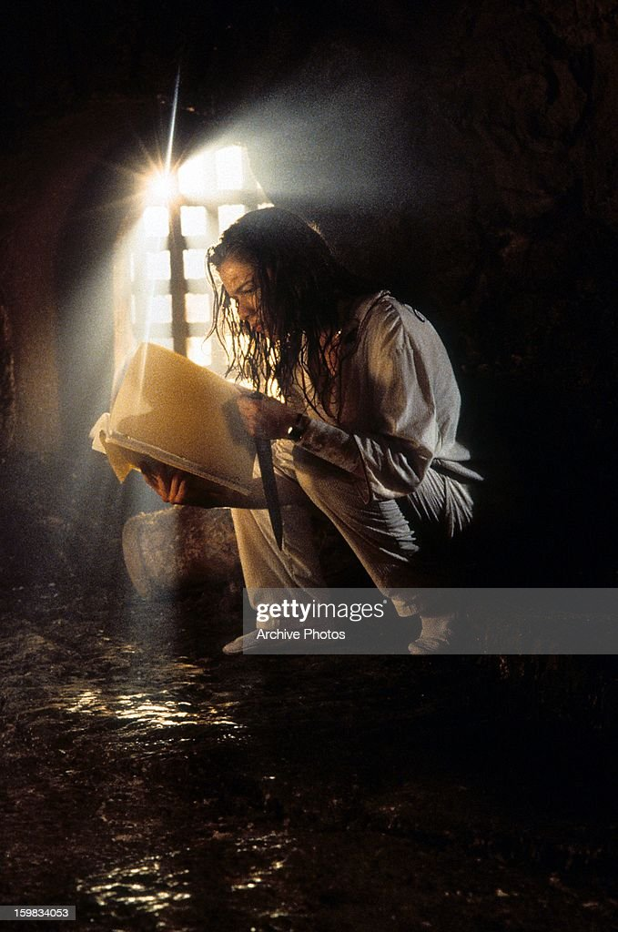 Heather Langenkamp reads a book in a scene from the film 'New Nightmare' 1994
