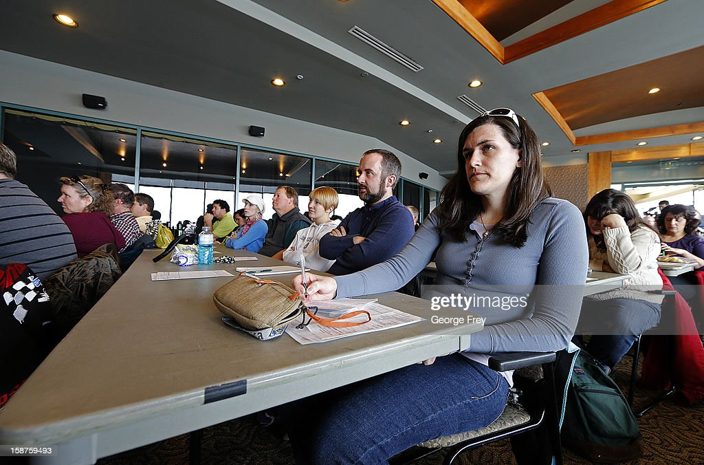 Heather Larson (C), a 2nd grade teacher along with other Utah teachers, listen to a concealed-weapons training class with 200 Utah teachers on December 27, 2012 in West Valley City, Utah. The Utah Shooting Sports Council said it would waive its $50 fee for concealed-weapons training for Utah teachers.