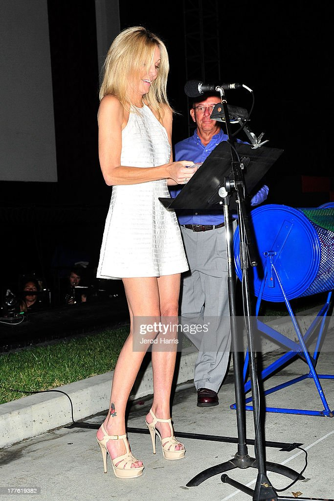 Heather Locklear announces the winner of the Acura raffle at the Acura/KOST celebrity benefit concert and pageant on August 24, 2013 in Laguna Beach, California.