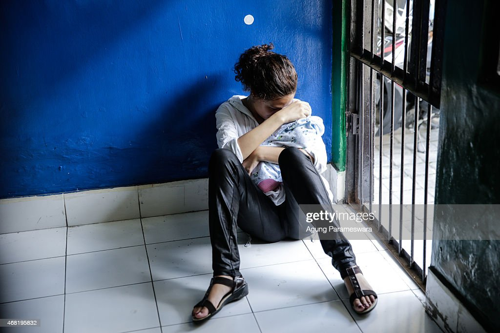 Heather Mack of the US holds her baby in a cell before her sentence demand trial on March 31 2015 in Denpasar Bali Indonesia Indonesian prosecutors...