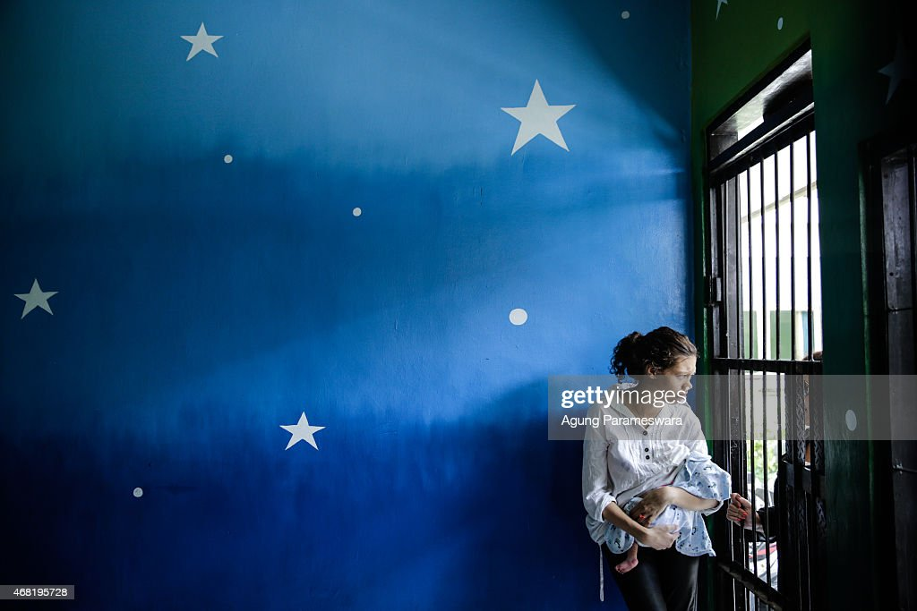 Heather Mack of the US holds her baby in a cell while she talk with his relative before her sentence demand trial on March 31 2015 in Denpasar Bali...