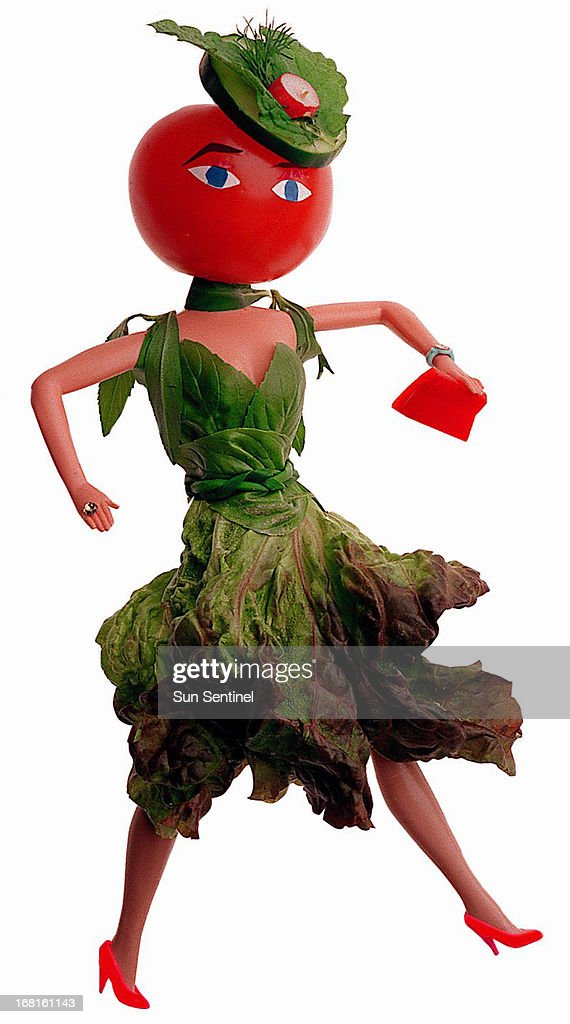 Heather McKinnon color illustration of 'salad woman' wearing a skirt of red leaf lettuce, a basil bustier, a braided chive belt, tarragon sleeves and scarf and a cucumber hat garnished with mint and dill. (Sun Sentinel (Fort Lauderdale, Fla.)/MCT via Getty Images)
