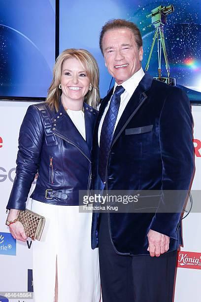 Heather Milligan and Arnold Schwarzenegger attend the Goldene Kamera 2015 on February 27 2015 in Hamburg Germany