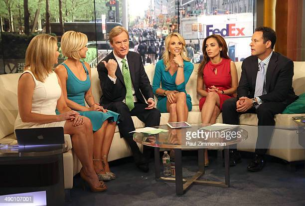 Heather Nauert Kellie Pickler Steve Doocy Elisabeth Hasselbeck Maria Molina and Brian Kilmeade visit 'FOX Friends' at FOX Studios on May 13 2014 in...