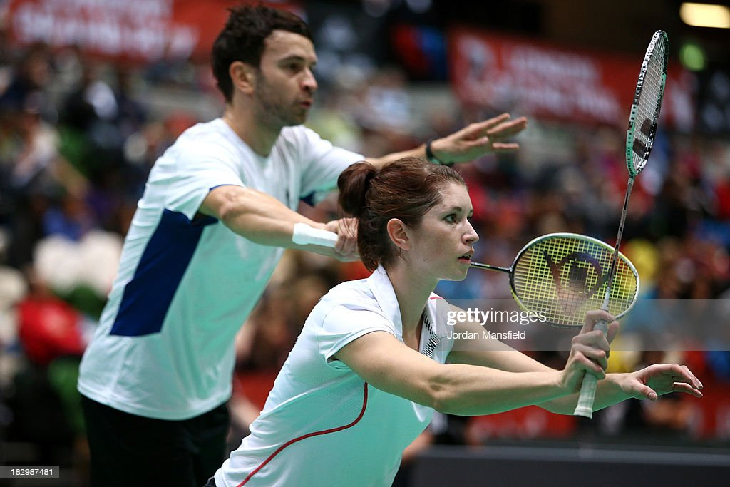 Heather Oliver (r) and Chris Langridge (l) of England in action during their mixed doubles match against Andrew Ellis and Lauren Smith of England during Day 3 of the London Badminton Grand Prix at The Copper Box on October 3, 2013 in London, England.
