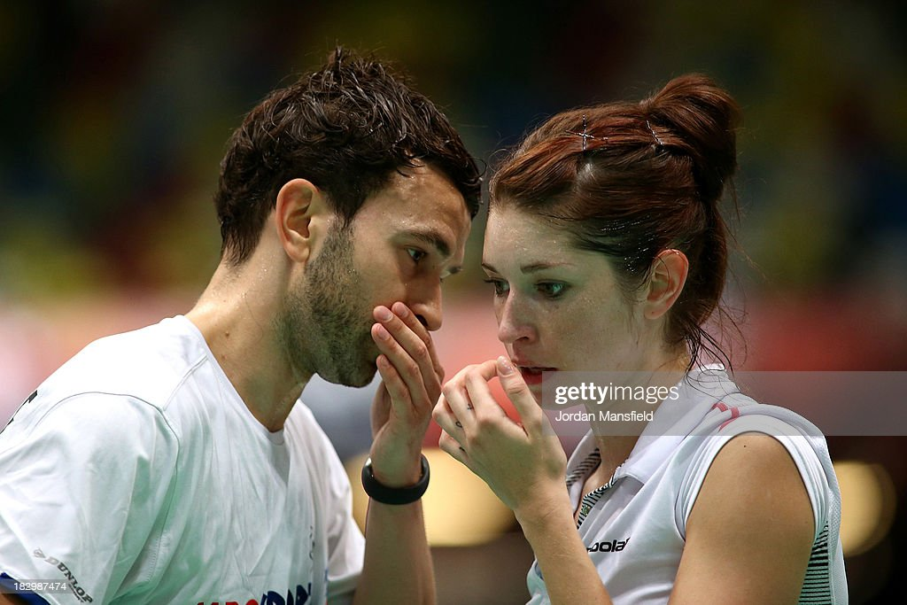 Heather Oliver (r) and Chris Langridge (l) of England whisper to each other during their mixed doubles match against Andrew Ellis and Lauren Smith of England during Day 3 of the London Badminton Grand Prix at The Copper Box on October 3, 2013 in London, England.