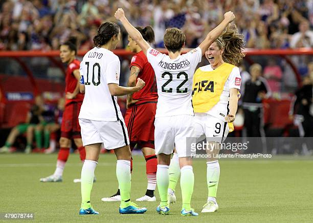 Heather O'Reilly celebrates with Carli Lloyd and Meghan Klingenberg of the United States after USA defeats Germany 20 in the FIFA Women's World Cup...