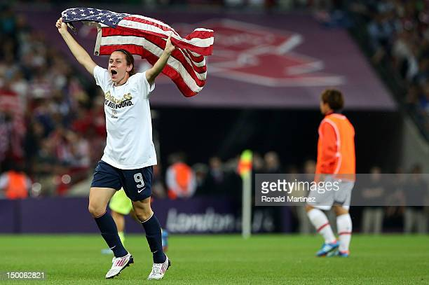 Heather O'Reilly of the United States celebrates with the American flag after defeating Japan by a score of 21 to win the Women's Football gold medal...