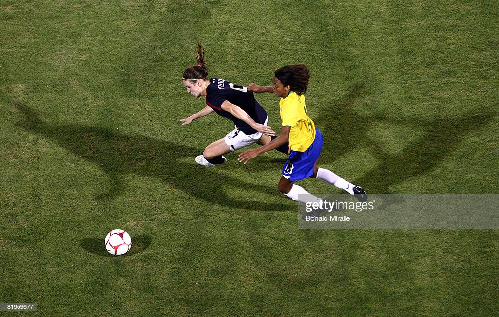 Heather O'Reilly of the United States is defended by Dani of Brazil during the International Friendly Match between Brazil and the United States at...