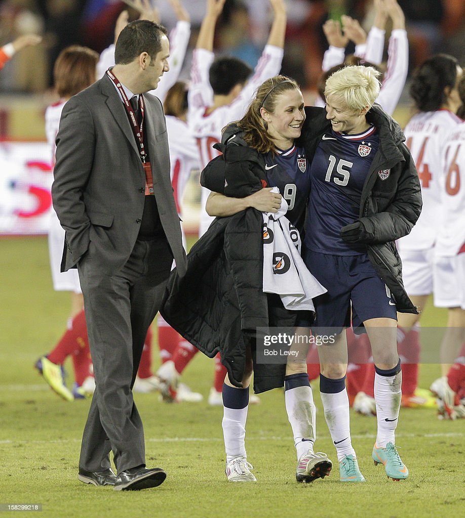 Heather O'Reilly (9) of the United States shares a moment with Megan Rapinoe (15) after defeating of China in the second half at BBVA Compass Stadium on December 12, 2012 in Houston, Texas. USA won 4-0.
