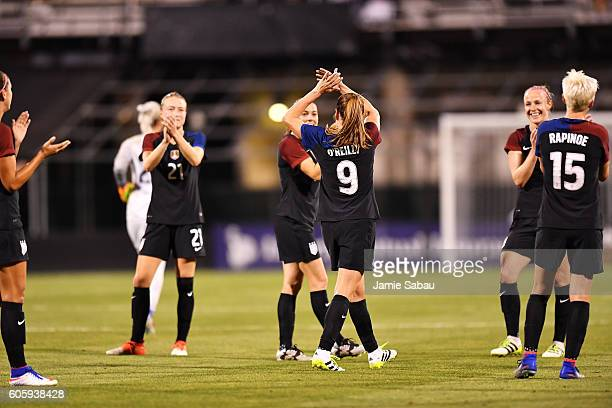 Heather O'Reilly of the US Women's National Team is honored by her teammates as she leaves the game near the end of a match against Thailand on...
