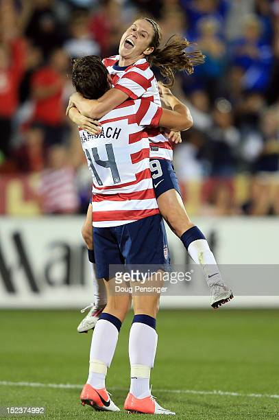 Heather O'Reilly of the USA celebrates her goal in the 22st minute against Australia with Abby Wambach of the USA at Dick's Sporting Goods Park on...