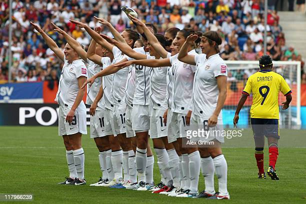 Heather O'Reilly of USA celebrates her team's first goal with team mates during the FIFA Women's World Cup 2011 Group C match between USA and...