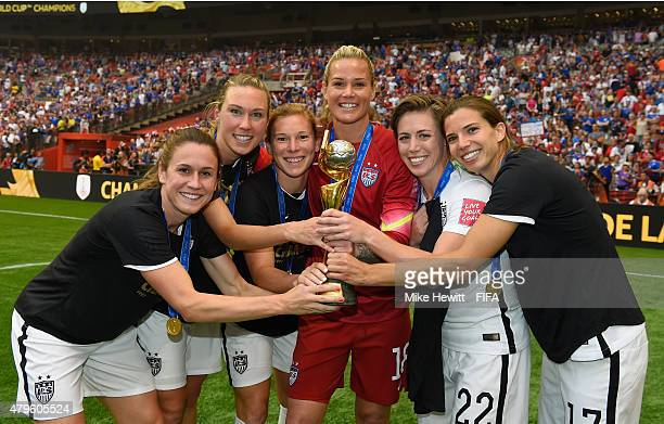 Heather O'Reilly Whitney Engen Lori Chalupny Ashlyn Harris Meghan Klingenberg and Tobin Heath of USA celebrate with the Trophy after the FIFA Women's...