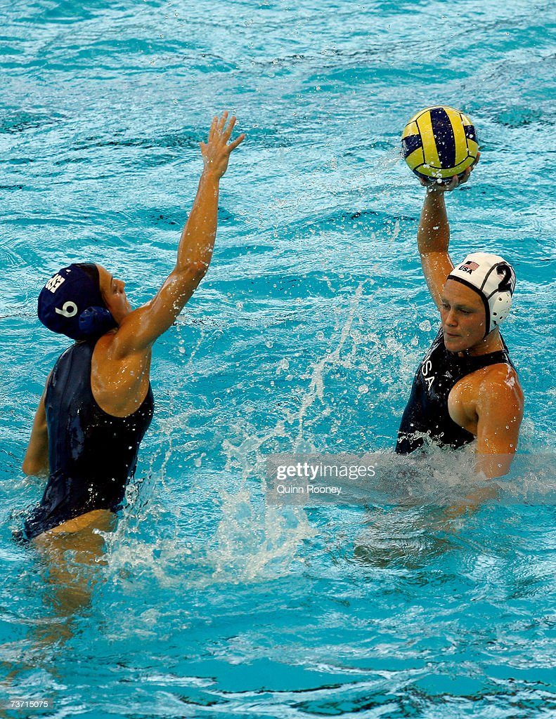 Heather Petri of the USA looks to pass with Jennifer Pareja Lisalde of Spain in defence during the Women's Quarter Final Round Water Polo match...