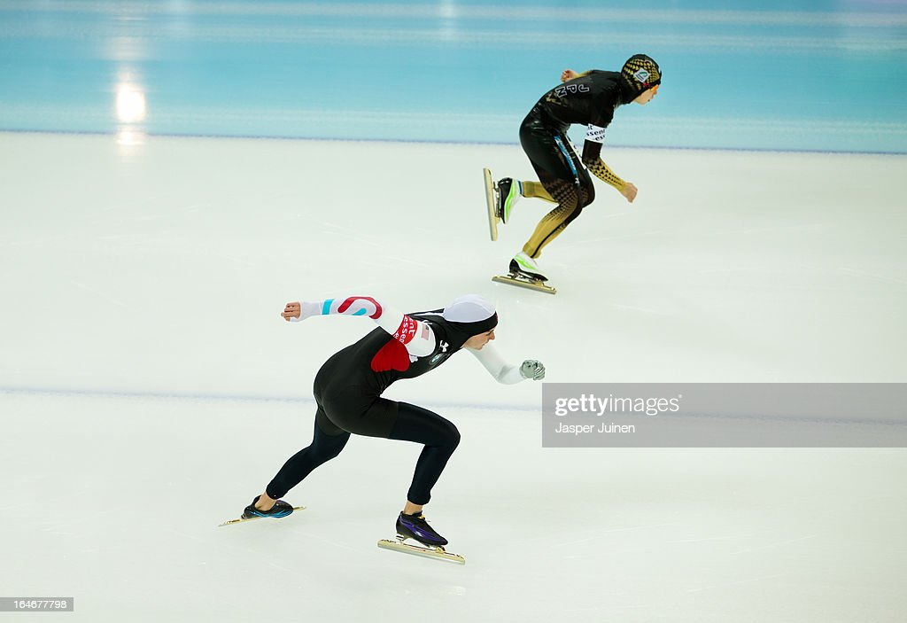 Heather Richardson (L) of the US competes against Nao Kodaira of Japan during the 500m race on day four of the Essent ISU World Single Distances Speed Skating Championships at the Adler Arena Skating Center on March 24, 2013 in Sochi, Russia.