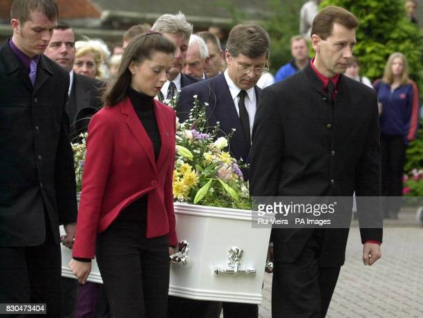 Heather Tell's father Peter carries her coffin into St Editha's Church Tamworth for the funeral of his daughter Heather The teenager's naked body was...