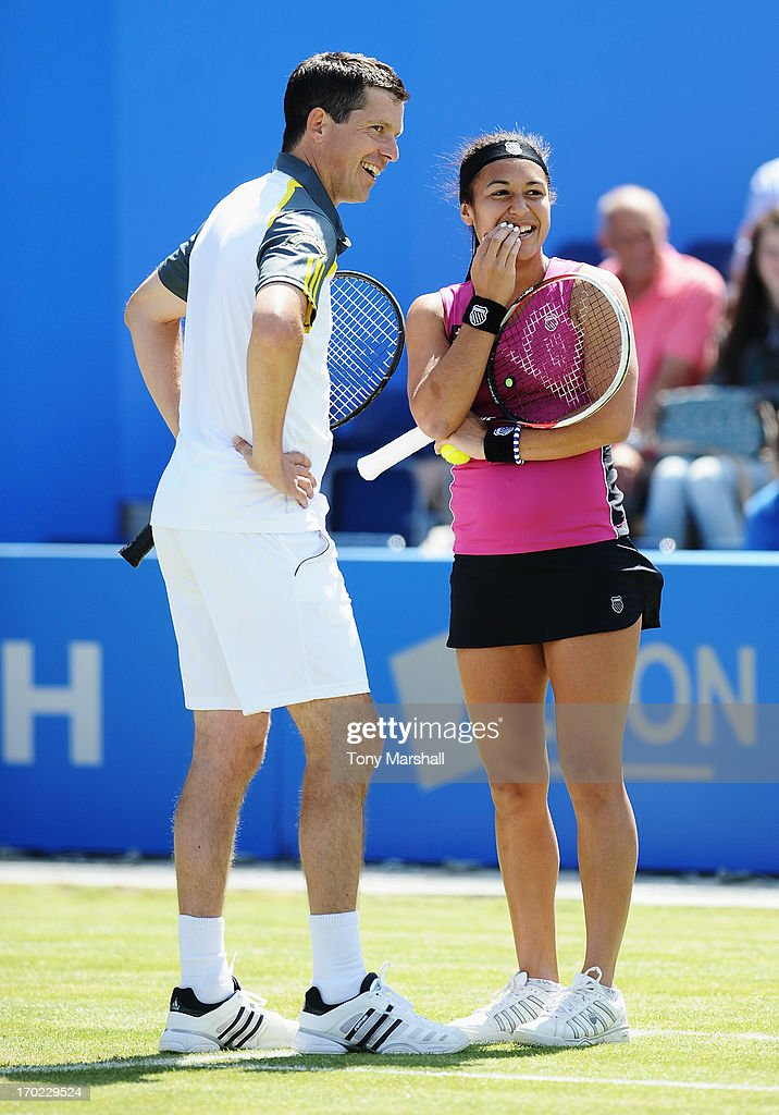 <a gi-track='captionPersonalityLinkClicked' href=/galleries/search?phrase=Heather+Watson&family=editorial&specificpeople=5418928 ng-click='$event.stopPropagation()'>Heather Watson</a> and <a gi-track='captionPersonalityLinkClicked' href=/galleries/search?phrase=Tim+Henman&family=editorial&specificpeople=167277 ng-click='$event.stopPropagation()'>Tim Henman</a> of Great Britain laugh in their mixed doubles exhibition match against Greg Rusedski and Sorana Cirstea of Romania during day one of the AEGON Classic tennis tournament at Edgbaston Priory Club on June 9, 2013 in Birmingham, England.