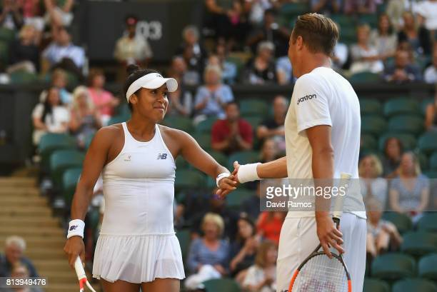 Heather Watson of Great Britain and Henri Kontinen of Finland celebrate a point in the Mixed Doubles quarter final match against Rohan Bopanna of...