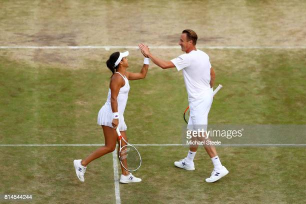 Heather Watson of Great Britain and Henri Kontinen of Finland celebrate a point during the Mixed Doubles semi final match against Elena Vesnina of...