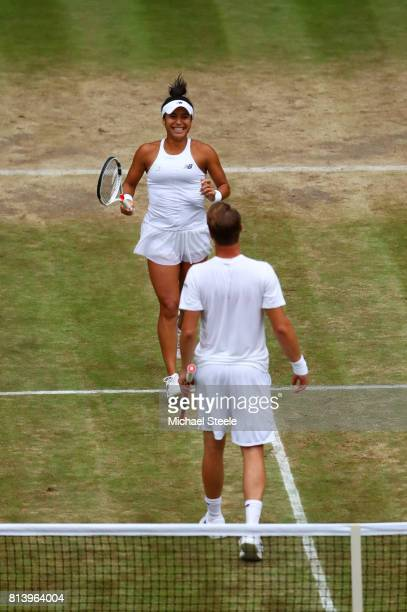 Heather Watson of Great Britain and Henri Kontinen of Finland celebrate victory after the Mixed Doubles quarter final match against Rohan Bopanna of...