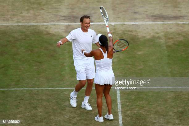 Heather Watson of Great Britain and Henri Kontinen of Finland celebrate victory after the Mixed Doubles semi final match against Elena Vesnina of...