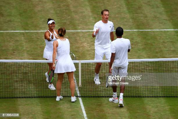 Heather Watson of Great Britain and Henri Kontinen of Finland and Rohan Bopanna of India and Gabriela Dabrowski of Canada shake hands after the Mixed...