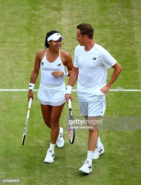 Heather Watson of Great Britain and Henri Kontinen of Finland in conversation during the Mixed Doubles Semi Finals match against Oliver Marach of...