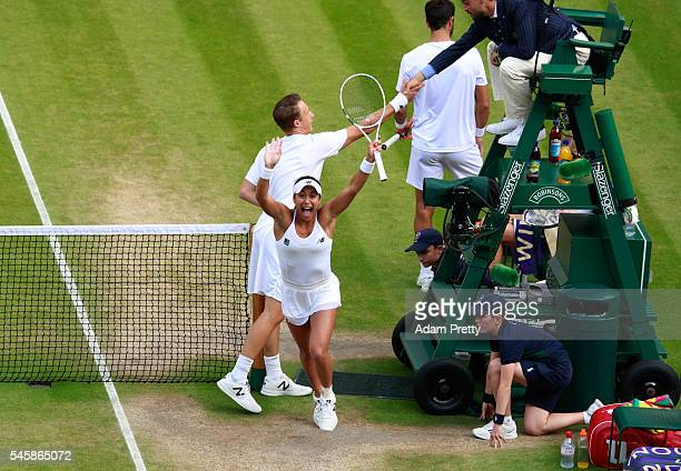 Heather Watson of Great Britain and Henri Kontinen of Finland celebrate victory in the Mixed Doubles Final against Robert Farah of Columbia and...